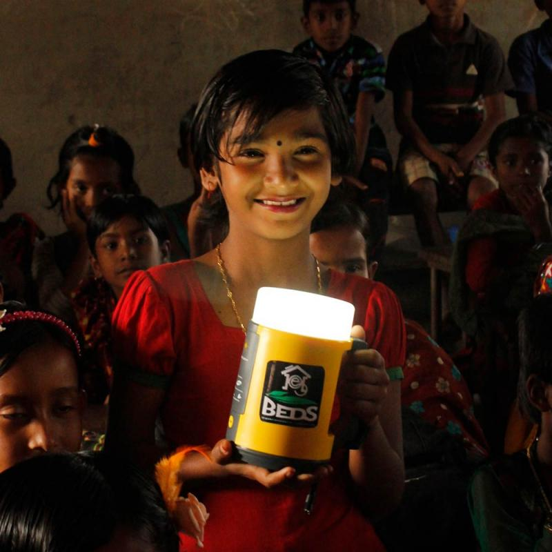 A child holds a solar lamp.